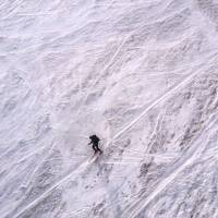 Heading home in style:  The author makes his daring descent on skis. | OSCAR BOYD