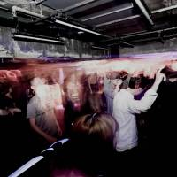 Everybody dance now: Music fans listen to a DJ at Alzar in Osaka. The club hopes to appeal to a mix of tourists, young Japanese and aspiring musicians.