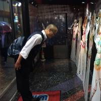 Paying respect: Fans often worship their anime idols at 'sacred sites,' leaving Shinto votive tablets or bowing before an image, as in this recreation by one of the book's authors.