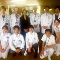 A job well done: Siok Hui Leong is pictured on the last day of her stay at Keio University Hospital, flanked by doctors Taizo Hibi (second from left) and Tsunichi Imai. Dr. Takuya Minagawa crouches second from left on the bottom row, along with nurses Kawata (second from right) and Kawabe (right).