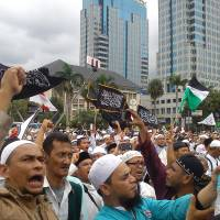 Protesters demonstrate in March against Jakarta Gov. Basuki Tjahaja Purnama, a Christian who was arrested on blasphemy charges and subsequently convicted and jailed. | CAHAYA MAULIDIAN