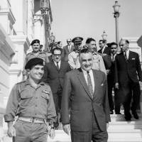 King Hussein of Jordan (left) and Egyptian President Gamal Nasser smile after signing a mutual defense agreement in Cairo on June 1, 1967. Four days later, Israel launched a pre-emptive strike against Egyptian forces as they mobilized on its border, starting a war that led to the defeat of Egypt, Syria and Jordan, and changed the Middle  East forever. | AFP-JIJI