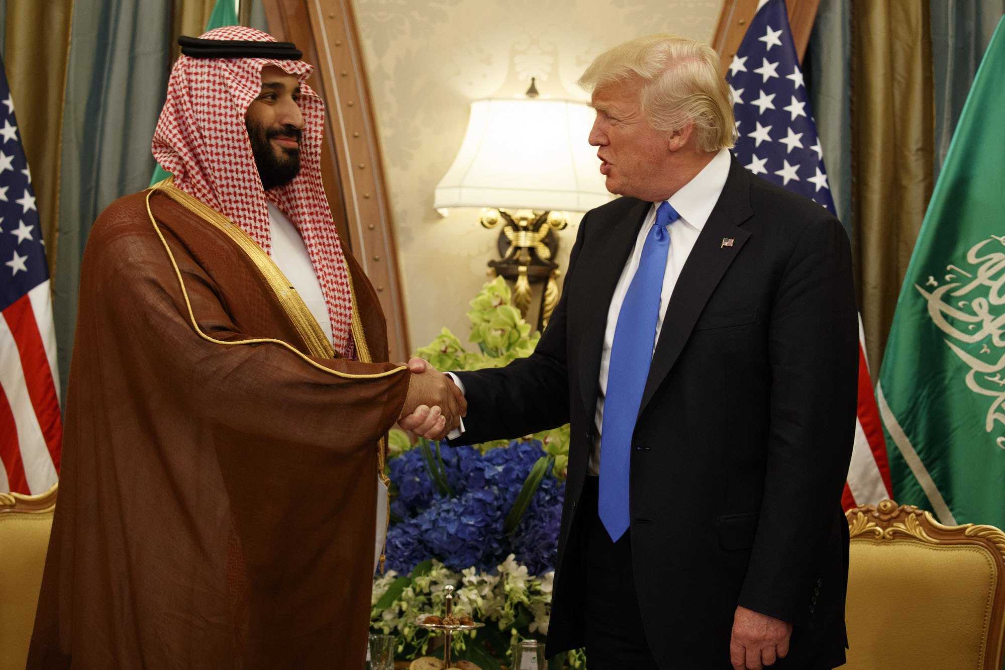 Saudi Defense Minister and then-Deputy Crown Prince Mohammed bin Salman shakes hands with U.S. President Donald Trump during a bilateral meeting in Riyadh on May 20.  Salman, who was named crown prince on June 21, has been responsible for a more aggressive Saudi stance in regional affairs.   AP