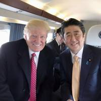 Prime Minister Shinzo Abe and U.S. President Donald Trump developed a close rapport during their February U.S. summit, as seen in a photo taken during a Feb. 10 flight aboard the Marine One presidential helicopter that was later tweeted by Trump. | KYODO