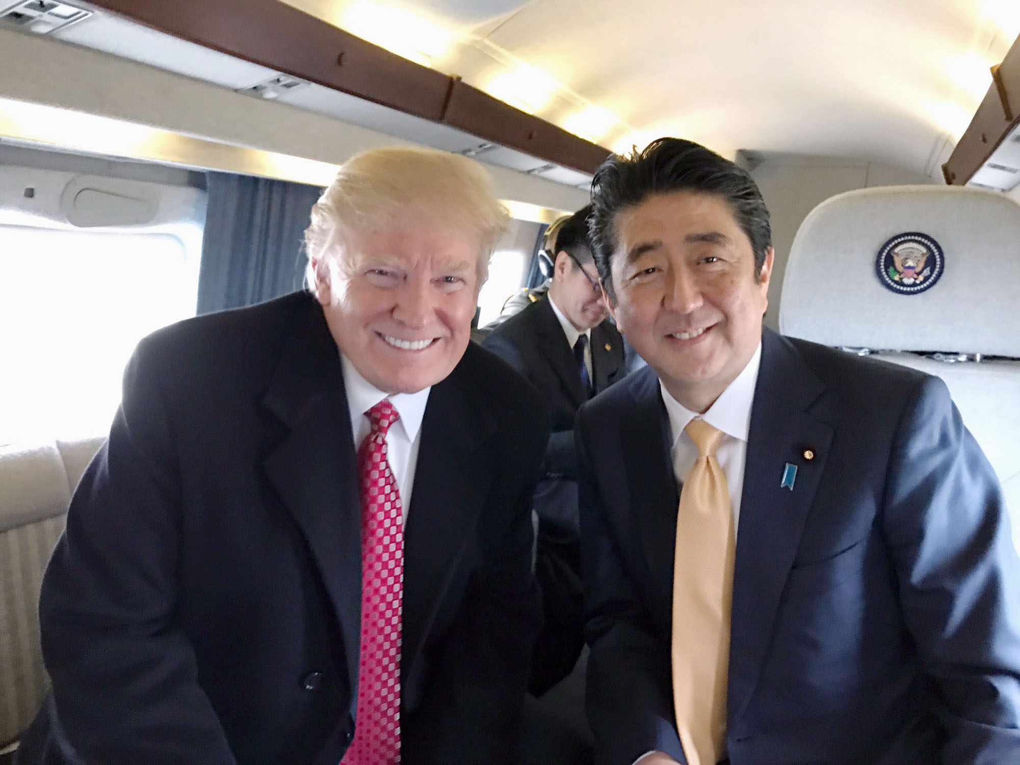 Prime Minister Shinzo Abe and U.S. President Donald Trump developed a close rapport during their February U.S. summit, as seen in a photo taken during a Feb. 10 flight aboard the Marine One presidential helicopter that was later tweeted by Trump.   KYODO