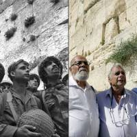Israeli paratroopers Tzion Karasenti (left), Yitzhak Yifat (center) and Haim Oshri stand next to the Western Wall, Judaism's holiest site in the Old City of Jerusalem, after it was captured on June 7, 1967, and re-create the scene 50 years later. | AFP-JIJI