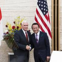 Deputy Prime Minister Taro Aso and U.S. Vice President Mike Pence appear at  a joint news conference following the first U.S.-Japan economic dialogue on April 18. | BLOOMBERG