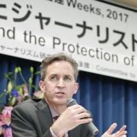 U.N. special rapporteur on freedom of expression David Kaye, shown at a Tokyo news conference on Friday, has criticized Japan's record on freedom of opinion and expression. | KYODO