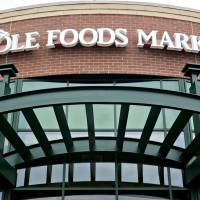 Amazon.com Inc. will acquire Whole Foods Market Inc. for $13.7 billion, a bombshell of a deal that catapults the e-commerce giant into hundreds of physical stores and fulfills a long-held goal of selling more groceries. | BLOOMBERG