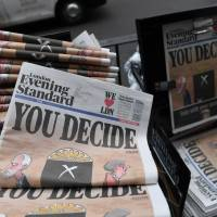 Copies of the Evening Standard newspaper, with the headline 'You decide' are pictured in central London on Thursday. | AFP-JIJI