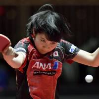 Miu Hirano competes against Suthasini Sawettabut of Thailand during the women's singles second round at the World Table Tennis Championships on Wednesday in Dusseldorf, Germany. Hirano won 4-0. | KYODO