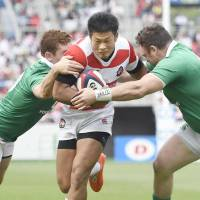 Japan's Ryuji Noguchi is tackled by two Ireland players during Saturday's test match in Shizuoka. | KYODO