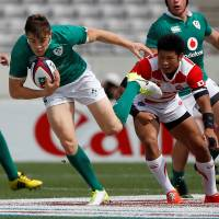 Ireland's Cian Healy runs with the ball against Japan on Saturday. | REUTERS