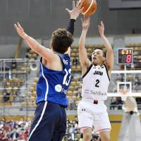 Japan's Yuki Togashi takes a first-quarter jumper against South Korea in their East Asia Basketball Association Championship Group A opener in Nagano on Saturday. Japan beat South Korea 78-72.   KYODO