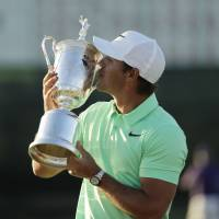 Brooks Koepka kisses the trophy after winning the U.S. Open on Sunday in Erin, Wisconsin. | AP