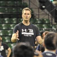 NFL superstar Tom Brady of the New England Patriots speaks at a clinic for Japanese quarterbacks at Ariake Colosseum on Wednesday. | HIROSHI IKEZAWA