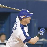 The Dragons'  Alex Guerrero raps out a single in the first inning against the Tigers at Nagoya Dome on Thursday. Chunichi defeated Hanshin 2-0 to complete a three-game sweep. | KYODO