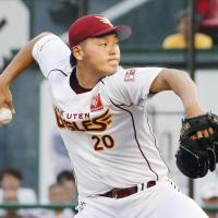 The Eagles' Tomohiro Anraku fires a pitch during Friday's game against the Hawks in Sendai. Tohoku Rakuten defeated Fukuoka SoftBank 4-3. | KYODO