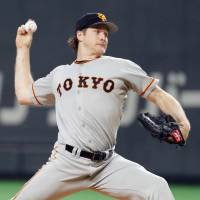 Giants hurler Miles Mikolas pitches on Friday against the Fighters. | KYODO