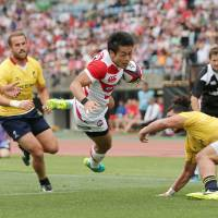 Japan holds off late Romania charge