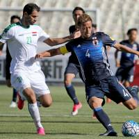 Japan captain Keisuke Honda prepares to shoot as Iraq's Saad Abdulameer defends during their 1-1 World Cup qualifying draw in Tehran on Tuesday. | AFP-JIJI