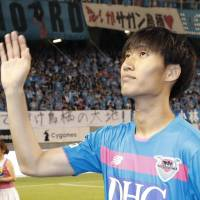 Daichi Kamada bids farewell to Sagan Tosu fans after his final game with the team on Sunday. | KYODO