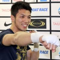 Middleweight fighter Ryota Murata poses for photos before a workout on Thursday.   KAZ NAGATSUKA