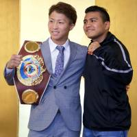 WBA super flyweight champion Naoya Inoue (left) and Roman Gonzalez pose for photos during a news conference to announce their upcoming bouts in September. | KAZ NAGATSUKA