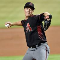 Greinke does it all as D-Backs edge Marlins