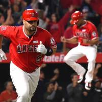 Pujols joins 600-homer club with grand slam