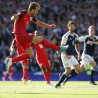 Kane rescues point for England against Scotland