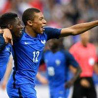 Dembele winner lifts France past England