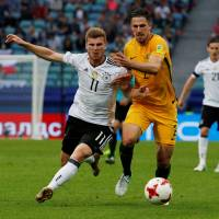Germany holds off Australia after goalkeeper's blunders