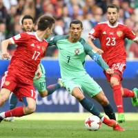 Superstar Ronaldo steers Portugal past Russia
