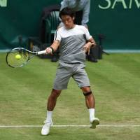 Yuichi Sugita plays a shot during his match against Roger Federer at the Gerry Weber Open in Halle, Germany, on Tuesday. | AFP-JIJI