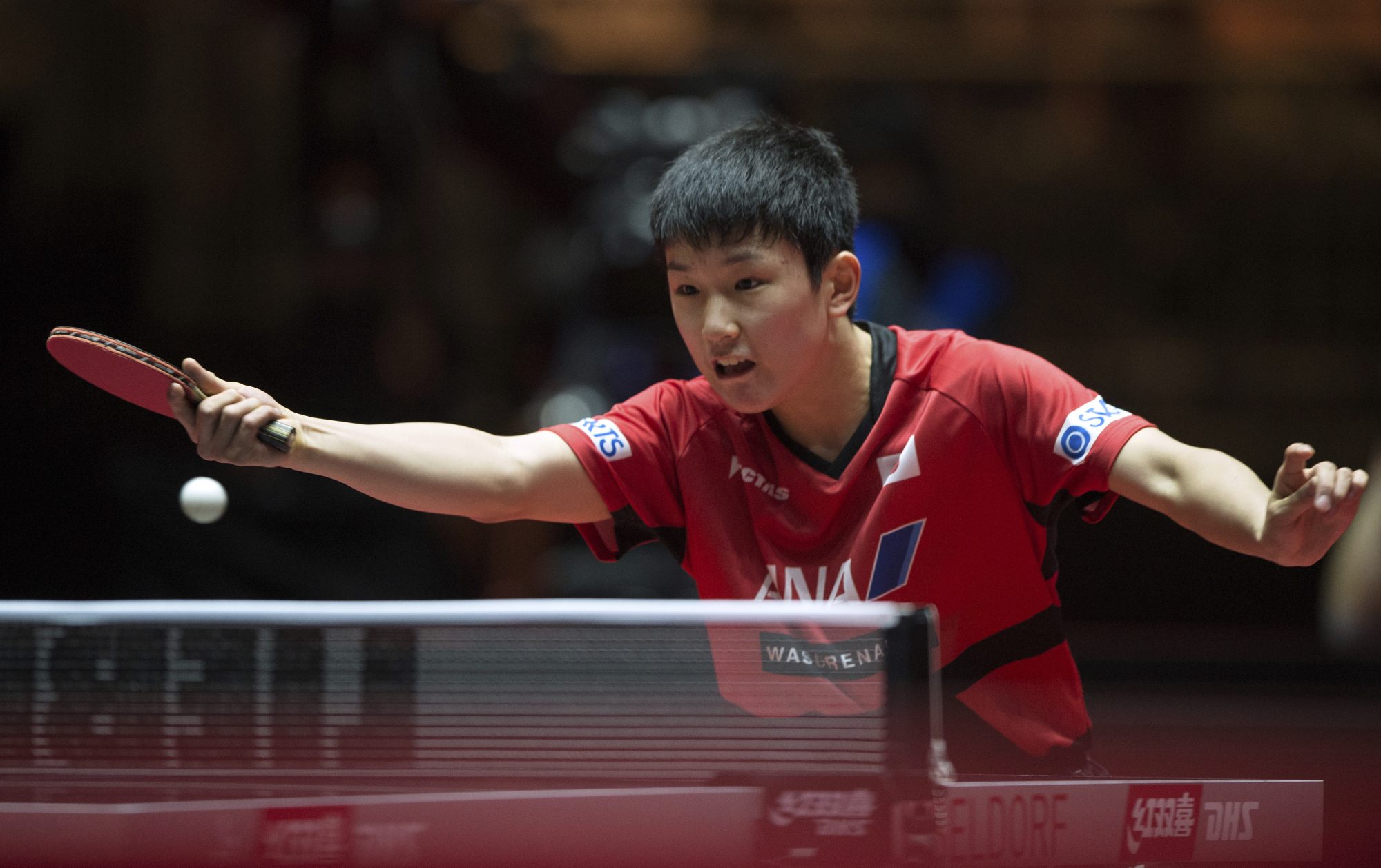 Tomokazu Harimoto competes against Jun Mizutani in the second round of the men's singles at the World Table Tennis World Championships in Duesseldorf, Germany, on Thursday.   AP