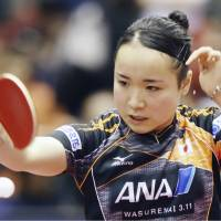 Mima Ito competes against Wang Manyu in the Japan Open women's singles quarterfinals on Saturday at Tokyo Metropolitan Gymnasium. | KYODO