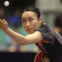 Mima Ito competes during the quarterfinals of the Japan Open on Saturday. | AP