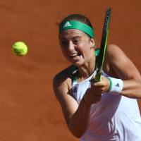 Ostapenko advances to French Open final on 20th birthday