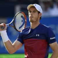 Murray stunned by lucky loser in Wimbledon warmup