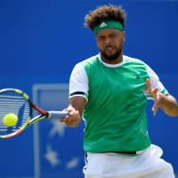 In-form Muller eliminates Tsonga
