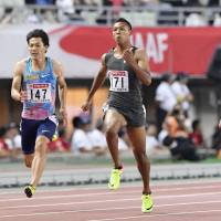 Sprinter Abdul Hakim Sani Brown (71) competes in a 100-meter preliminary heat on Friday at the  National Athletics Championships in Osaka. Sani Brown had the day's fastest time (10.06 seconds). | KYODO