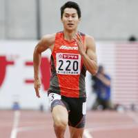 Shota Iizuka runs during a 200-meter qualifying heat at the National Athletics Championships on Saturday. Iizuka advanced to the final with the day's fastest time (20.40 seconds).   KYODO