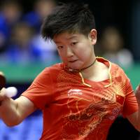 Novice Sun, top-ranked Ma win Japan Open titles