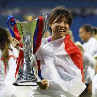 Olympique Lyonnais' Saki Kumagai celebrates after her team's triumph in the UEFA Women's Champions League final on Thursday in Cardiff, Wales. | REUTERS
