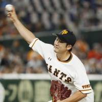 Giants starter Tomoyuki Sugano allowed five hits and one run in eight innings. | KYODO