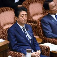 Abe won't abandon key economic goals as he pushes for constitutional reform, adviser says
