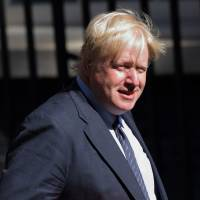 British Foreign Secretary Boris Johnson is seen in Downing Street in London last month. He arrived in Japan on Thursday for talks about trade and security issues.   BLOOMBERG