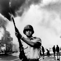 A National Guardsman stands at a Detroit intersection during July 1967 riots in the city. Detroit wasn't the first of the riots in the summer of 1967, and it was far from the last. Buffalo, New York, and Newark, New Jersey, preceded it; in the course of the summer, more than 150 cases of civil unrest erupted across the United States. | AP