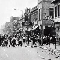 Hundreds of people run down 12th Street on Detroit's west side throwing stones and bottles at storefronts in July 1967. The riot started after police raided an after-hours club in a predominantly African-American neighborhood. The raid, though, was just the spark. Many in the community blamed frustrations blacks felt toward the mostly white police, and city policies that pushed families into aging and overcrowded neighborhoods. | AP